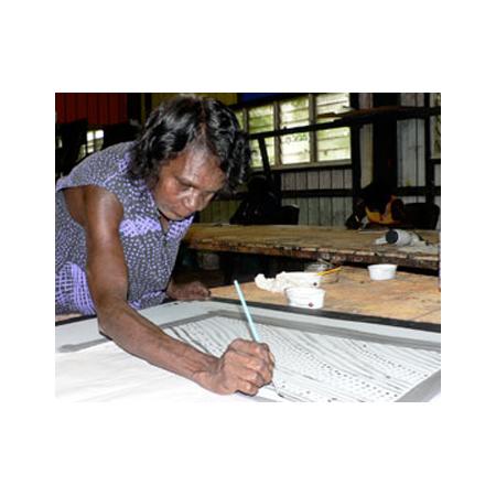 Jean Baptiste Apuatimi at Tiwi Design on Bathhurst Island working on her prints