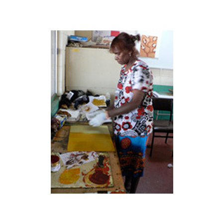 Image: Blanche Ebatarinja working on her print at the art centre.
