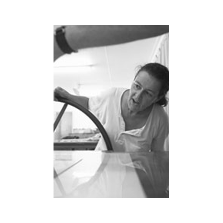 Winsome Jobling, in the studio, 'pulling' a print from the press.