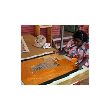 Beryl Jimmy working on her screenprint, © Tjungu Palya 2009