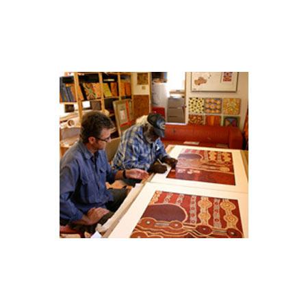 Print maker Basil Hall with artist David Miller signing his prints at Tjungu Palya Art Centre © Tjungu Palya 2009.